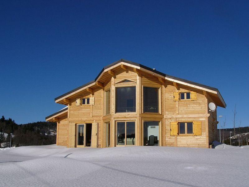 Maison ossature bois chalet poteaux poutres for Extension chalet bois